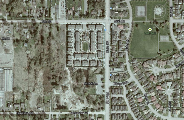 The park in question is to the left of the square of townhouses, a mostly treed rectangle.